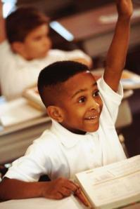 Boy_raising_hand