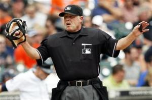 Home-plate umpire Jim Joyce reacts after Detroit Tigers' Magglio Ordonez scored against the Cleveland Indians during the third inning of their American League MLB baseball game in Detroit, Michigan June 3, 2010.       REUTERS/Rebecca Cook
